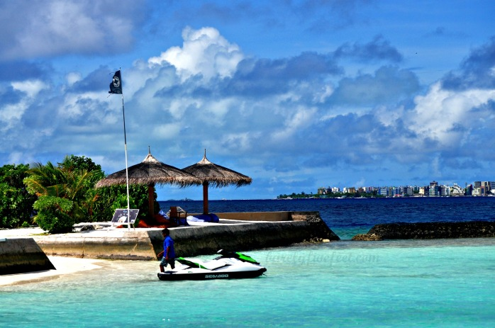 One of Kurumba Maldives' beach bars, with Malé City at the background